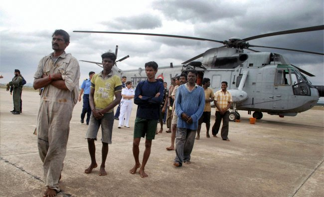 Fishermen come out of a helicopter after being rescued by the eastern Naval Command