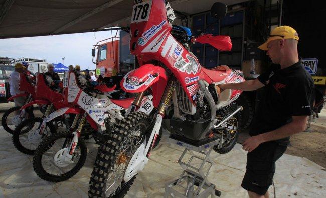 A mechanic checks motorcycle ahead of the 2012 Argentina-Chile-Peru Dakar Rally