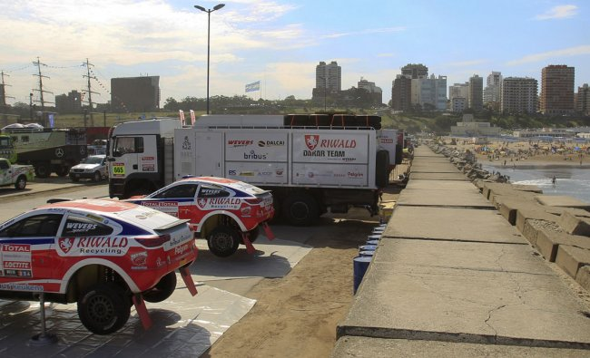 Vehicles are seen parked a day before the technical verification ahead of the 2012 Dakar Rally