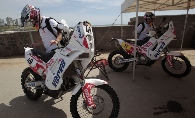 Bikers check their vehicle ahead of the Argentina-Chile-Peru Dakar Rally 2012