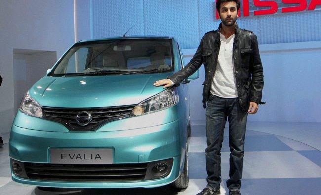 Bollywood actor Ranbir Kapoor poses with Nissan\'s Evalia car