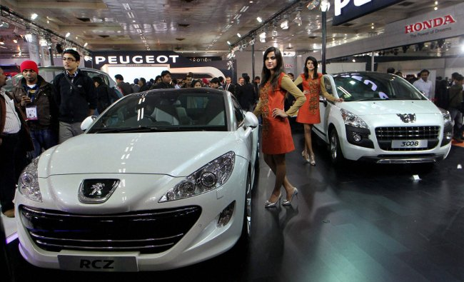 Visitors at the Peugeot stall at the 11th Auto Expo 2012