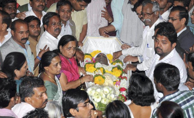 Relatives and family members gather as body of Anuj Bidve