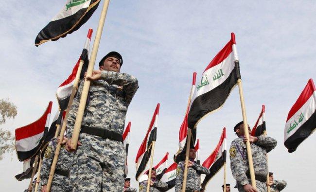 Iraqi federal police graduates march