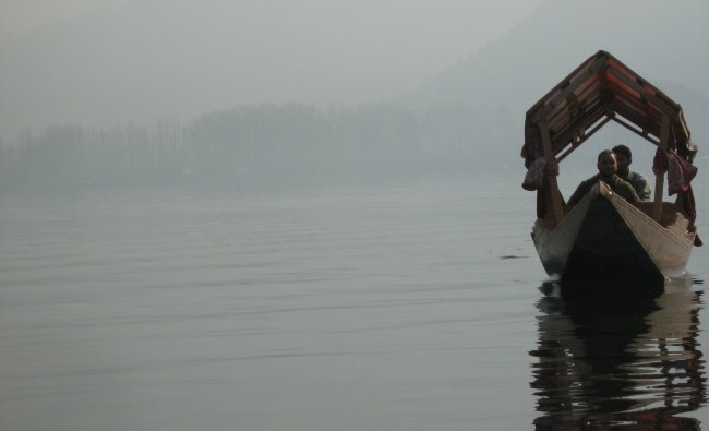 A local Kashmiri youth with his Shikara in early morning