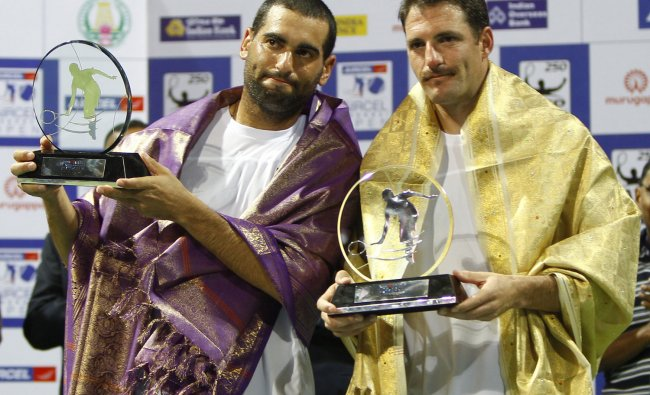 Jonathan Erlich and Andy Ram react as they hold the runners-up trophies at the ATP Chennai Open