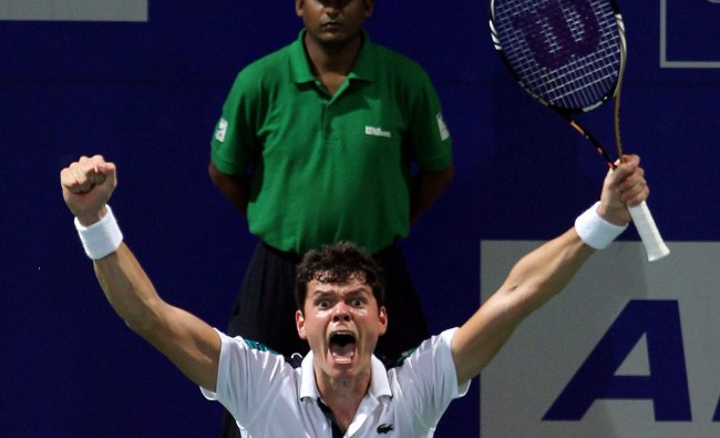 Milos Raonic celebrates after winning the final against Janko Tipsarevic at the Chennai Open