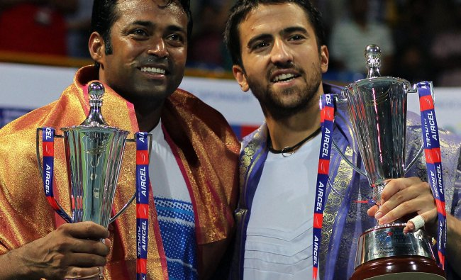 Leander Paes and J Tipsarevic pose with the trophies after winning the Chennai Open doubles match
