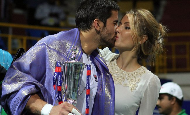 Janko Tipsarevic kisses his wife after winning the Chennai Open doubles final match