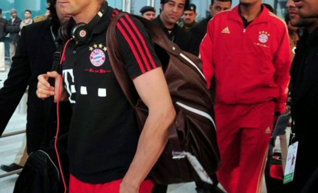 Members of FC Bayern Munich team prepare to leave for their hotel after their arrival