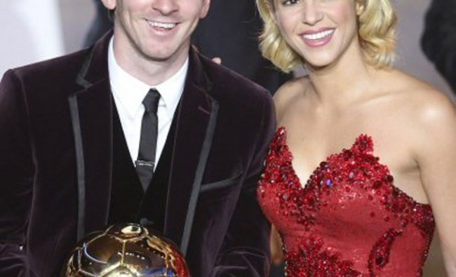 Argentina\'s Lionel Messi stands next to Colombian singer Shakira