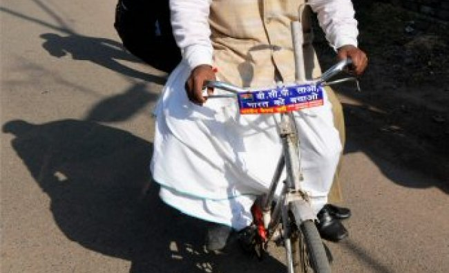 Dance of democracy - An independent candidate rides on a cycle...