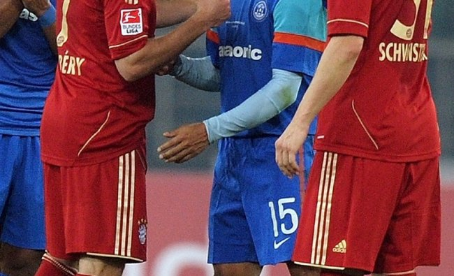Frank Ribery and Bastian Schweinsteiger with Baichung Bhutia