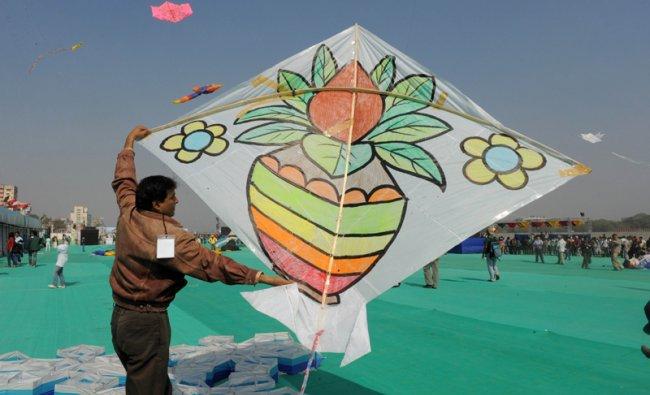 Kite enthusiast participate in the International Kite Festival at Sabarmati Riverfront