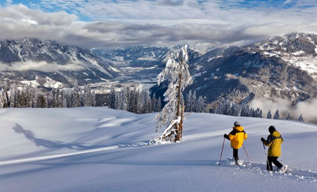 Tourists on snow shoes enjoy the wonderful winter weather in Switzerland
