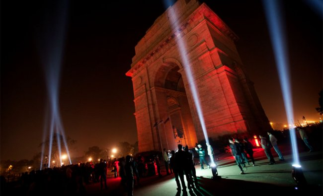People watch a laser light show on the India Gate Monument in New Delhi