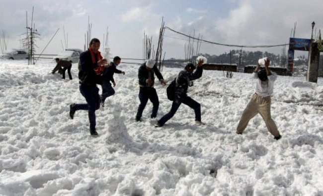 Youngsters enjoy with snow after a snowfall at Mcleodganj...