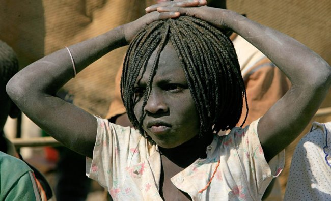 A Sudanese child looks on during a visit by Antonio Guterres