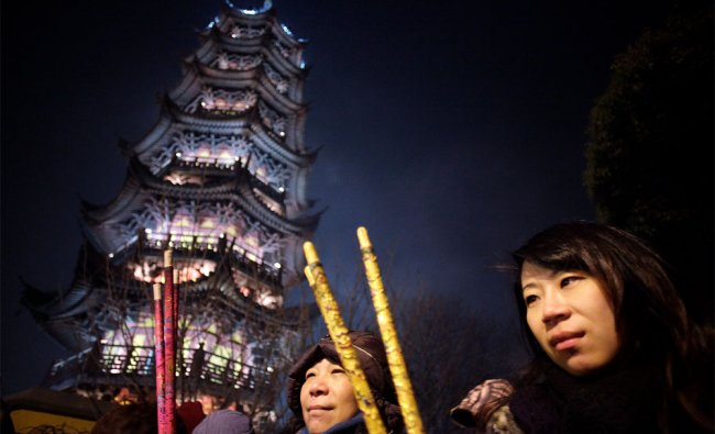 Worshippers burn joss sticks to pay thier first visit of the \