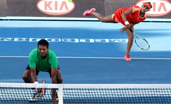 Sania Mirza and Mahesh Bhupathi during their second round mixed doubles match at Australian Open