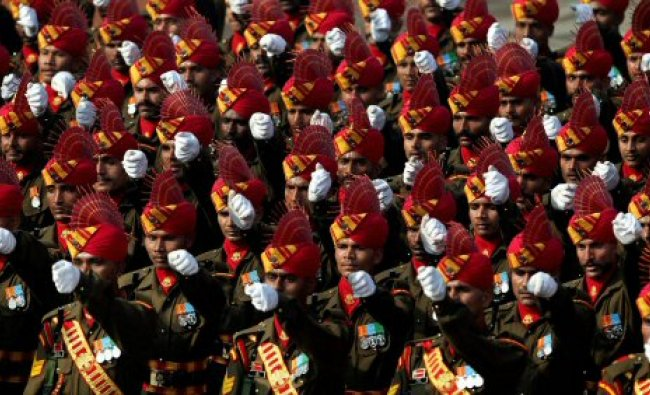 Soldiers march past at Rajpath during the full dress rehearsal...