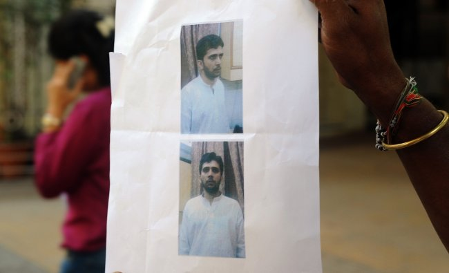 A copy of handout pictures released by the police of alleged masterminds of Mumbai serial blasts
