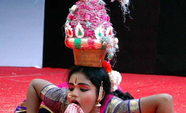 A kid display her tallent at the Bala Srujanotsava in Mangalore