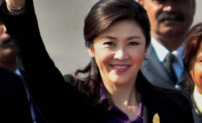 Yingluck Shinawatra, Prime Minister of Thailand, waves on her arrival...