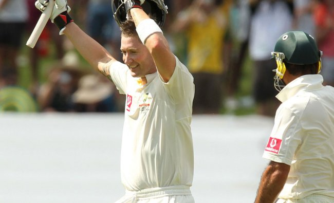 Michael Clarke (L) gestures to the crowd after scoring a century against India