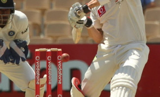Michael Clarke square drives on day 1 of the fourth cricket Test match against India