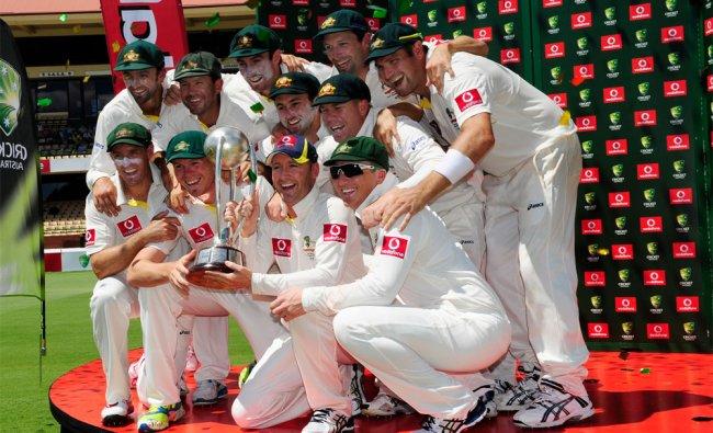 Australia\'s cricket players celebrate victory over India