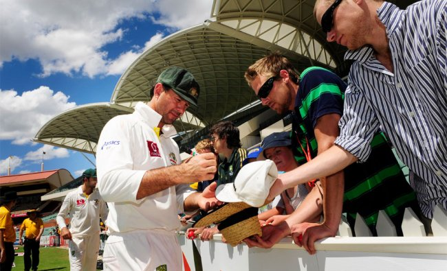 Ricky Ponting signs autographs after a cricket test match against India in Adelaide