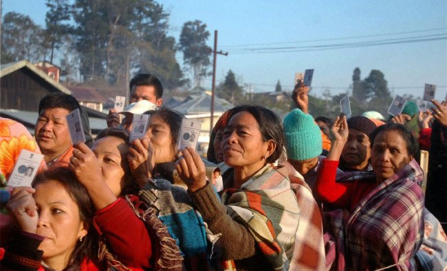 Women voters wait in queues to cast their votes at a polling station in Manipur