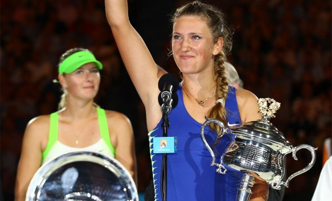 Victoria Azarenka holds the trophy after defeating Maria Sharapova in the Australian Open final