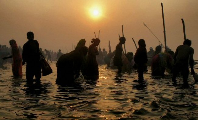Devotees taking holy dip at Sangam, the confluence of the Ganges...
