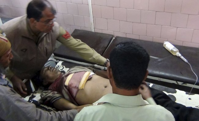 A wounded man is treated at a hospital at Imphal