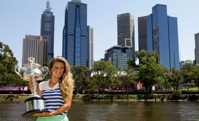 Victoria Azarenka of Belarus poses with her trophy on the banks of the Yarra River