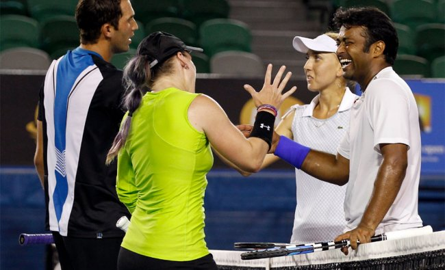 Leander Paes and his partner congratulate the winners of Australian Open Mixed Doubles final