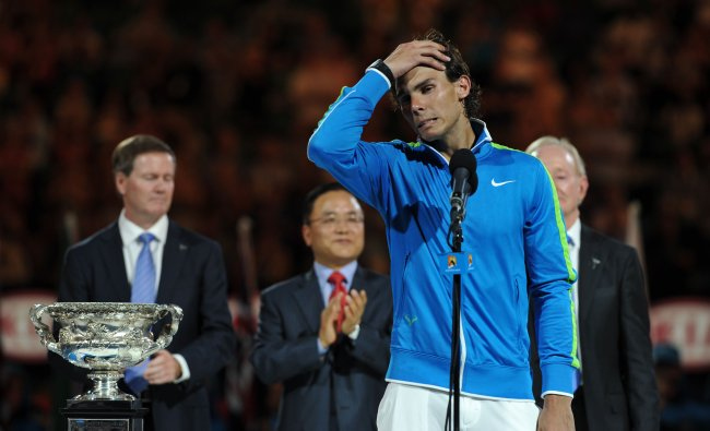 Rafael Nadal gestures as he addresses a ceremony after defeat