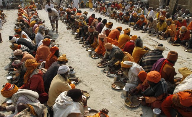 Hindu devotees participate in a community feast at Sangam