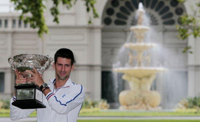 Australian Open men\'s singles champion Serbia\'s Novak Djokovic poses with his trophy at a park