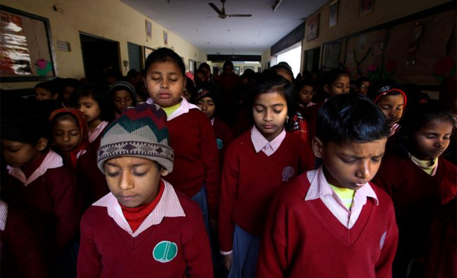 Students observe two minutes of silence to mark the death anniversary of the late Mahatma Gandhi