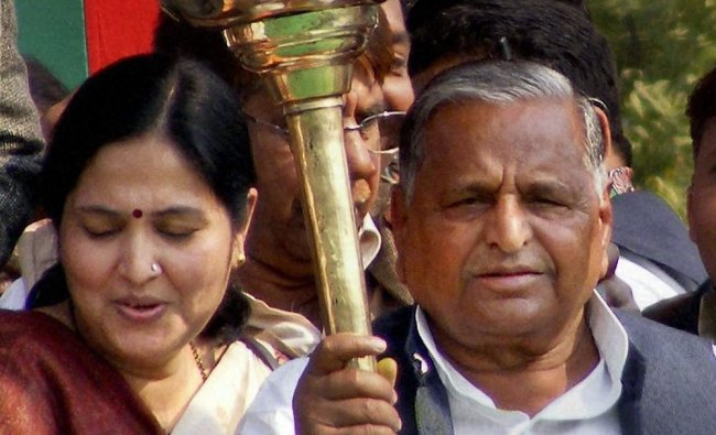 Mulayam Singh Yadav displays a mace during an election rally in Varanasi