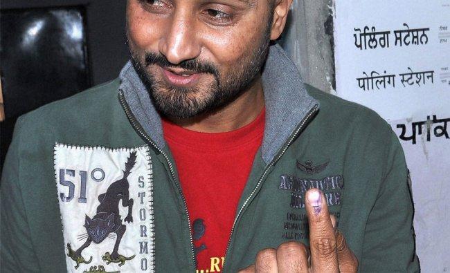 Harbhajan Singh shows his marked finger after casting his vote in Jalandhar