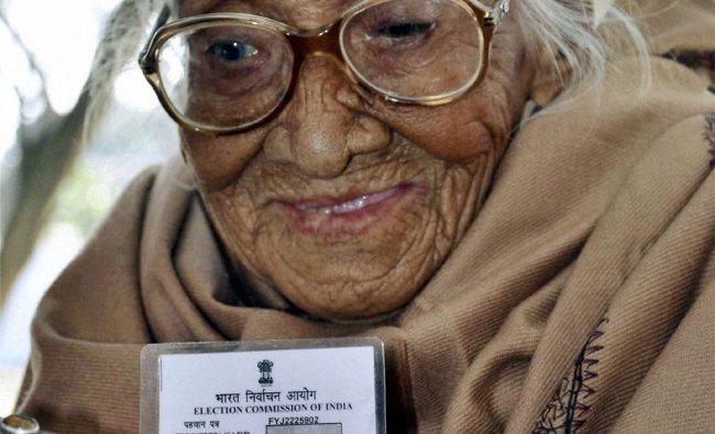 An octogenarian voter waits to cast her vote in Dehradun