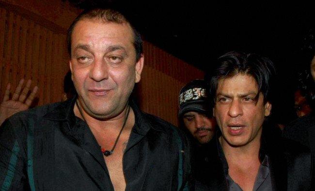 Actors Sanjay Dutt and Shahrukh Khan at a party