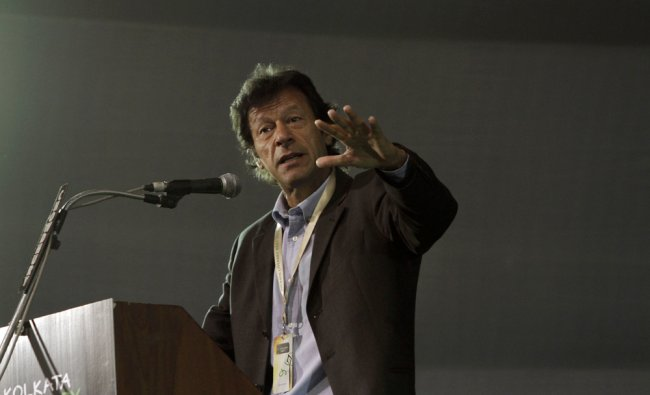 Imran Khan gestures as he speaks at the Kolkata Book Fair
