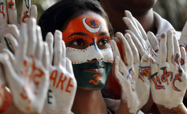 Indian students with their face and hands painted participate in a march for peace and communal...