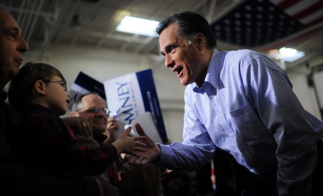 Republican presidential hopeful Mitt Romney greets supporters