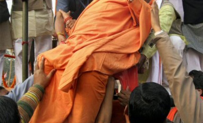 BJP leader Uma Bharti being carried on a chair...